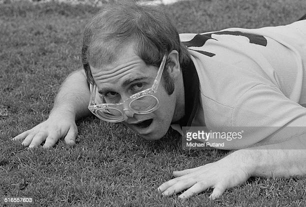 English singersongwriter and vicepresident of Watford FC Elton John on the pitch at the Vicarage Road stadium in Watford April 1974