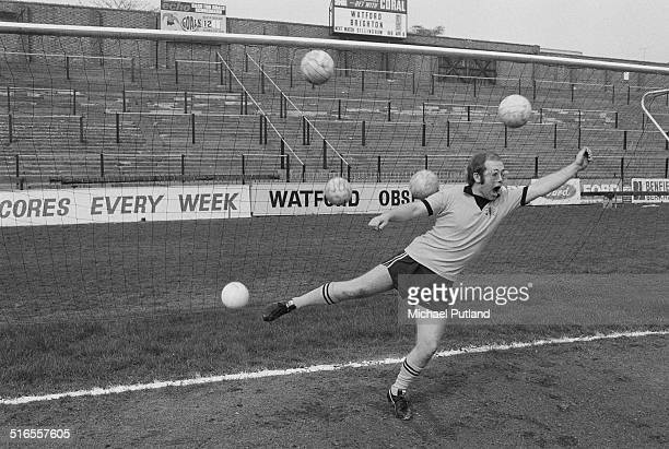 English singersongwriter and vicepresident of Watford FC Elton John is overwhelmed by multiple shots on goal at the Vicarage Road stadium in Watford...