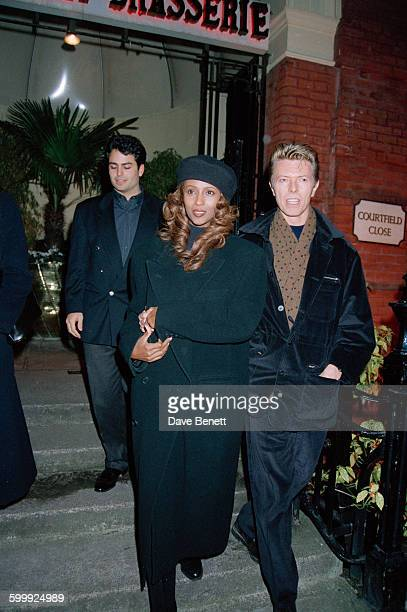 English singersongwriter David Bowie and his wife Iman leaving the Bombay Brasserie in South Kensington London 21st November 1993