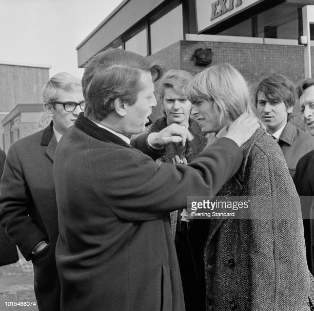 English singersongwriter David Bowie then still known as Davy Jones with members of his group The Manish Boys and TV producer Barry Langford at BBC...