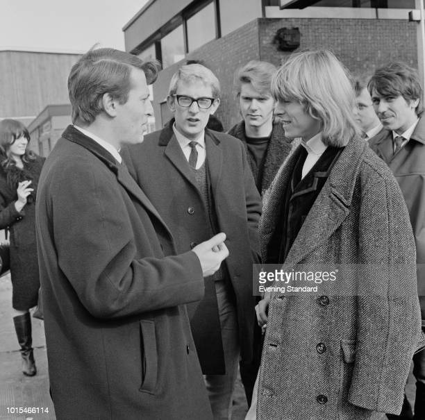 English singersongwriter David Bowie then still known as Davy Jones with members of his group The Manish Boys and producer Barry Langford at BBC TV...