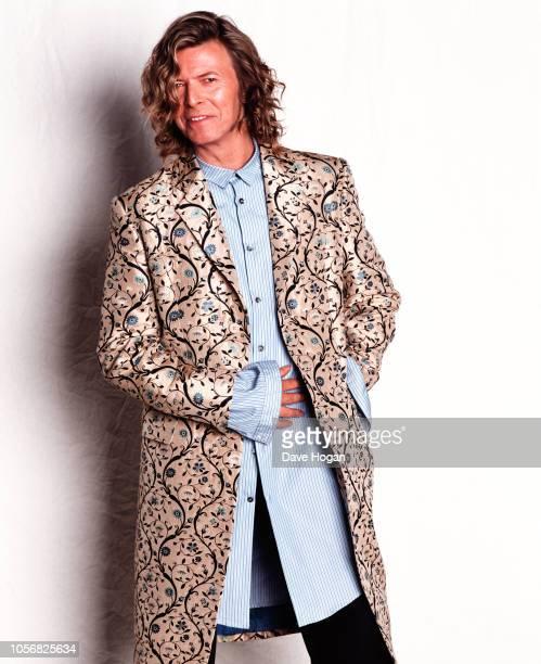 English singersongwriter David Bowie wearing a coat designed by Alexander McQueen backstage at the Glastonbury Festival Worthy Farm near Pilton...
