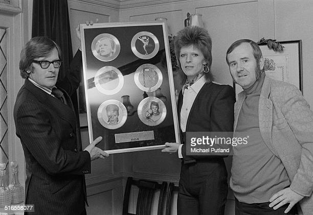 English singer-songwriter David Bowie with an award 'For Outstanding Musical Achievements', from RCA Records, January 1974. The award features...