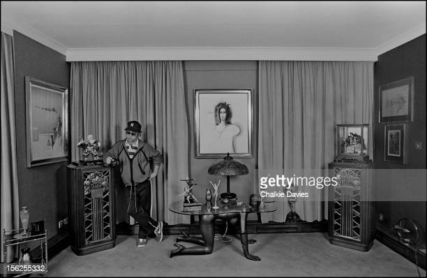 English singersongwriter Elton John in the bedroom at his home in Old Windsor Berkshire 1978 At centre is a table by British pop artist Allen Jones...