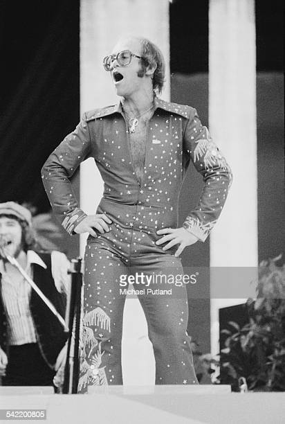 English singer-songwriter Elton John performing at the 'Midsummer Music' one-day festival at Wembley Stadium, London, 21st June 1975. John performed...
