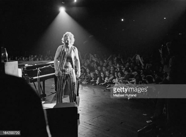 English singersongwriter Elton John performing on stage 1973