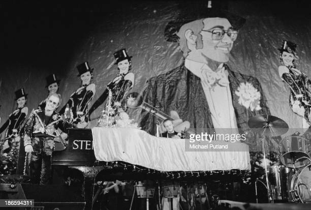 English singer-songwriter Elton John performing on stage during his Christmas show at the Hammersmith Odeon, London, 21st December 1973.