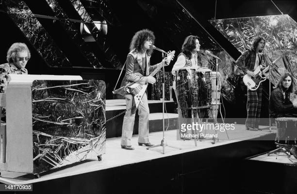 English singersongwriter Elton John performing with glam rock group TRex on the Christmas edition of the BBC TV music programme 'Top Of The Pops'...
