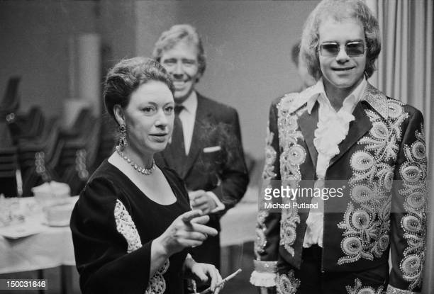 English singersongwriter Elton John with Princess Margaret and her husband Lord Snowdon backstage at a benefit concert held at the Shaw Theatre...