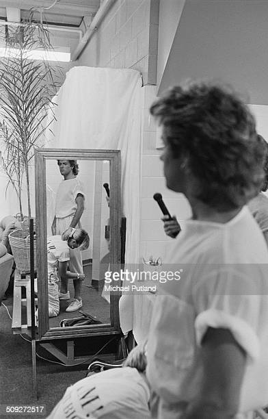 English singersongwriter George Michael in a dressing room during the 'Wham' tour of Japan and Australia 1985