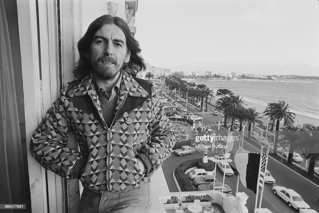 English singer-songwriter, guitarist and former Beatle, George Harrison (1943 - 2001) on a hotel balcony in Cannes, France, 30th January 1976. Harrison is in Cannes for the Midem music industry trade fair. He is wearing a 'Jim Keltner Fan Club' badge