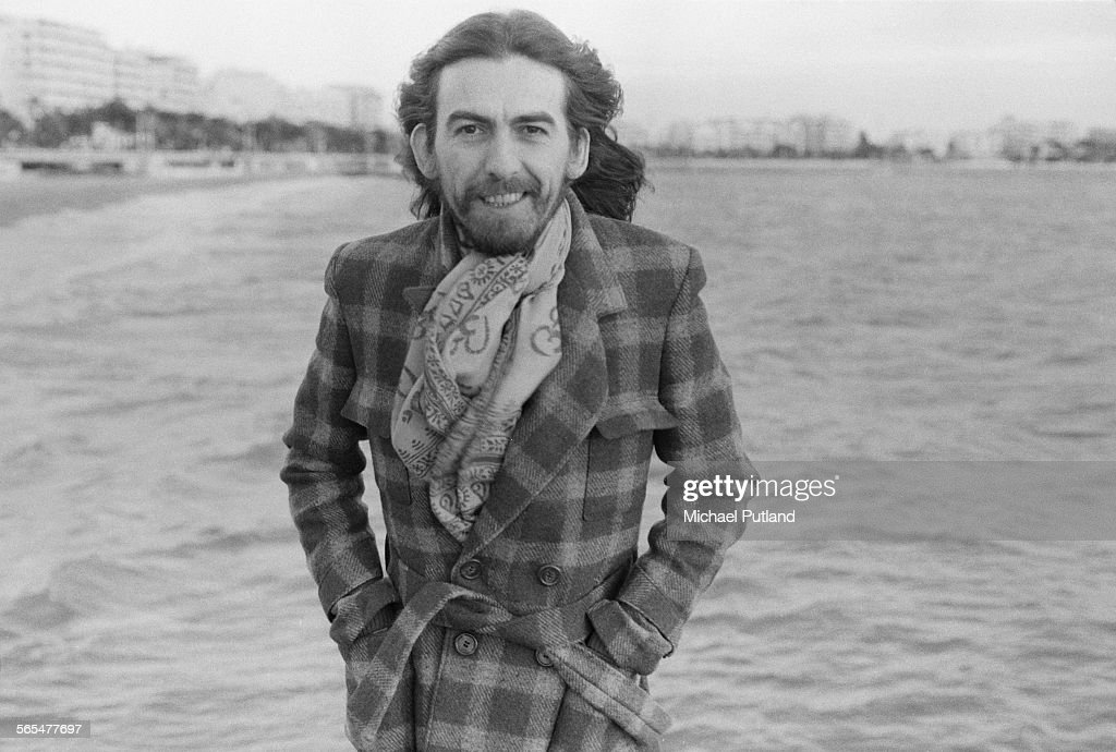 English singer-songwriter, guitarist and former Beatle, George Harrison (1943 - 2001) on the beach in Cannes, France, 30th January 1976. Harrison is in Cannes for the Midem music industry trade fair.