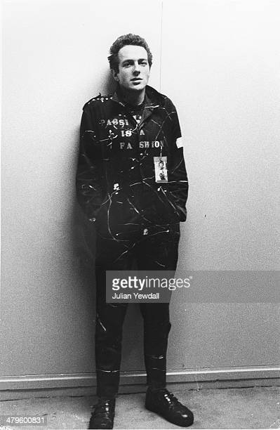 English singer-songwriter Joe Strummer , of punk group The Clash, backstage at a concert at the Royal College of Art , London, 5th November 1976.