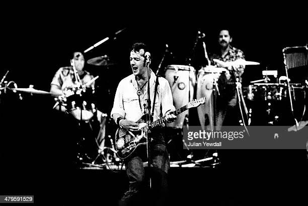English singersongwriter Joe Strummer performing with rock group The Latino Rockabilly War at the Hackney Empire London during the Green Wedge...