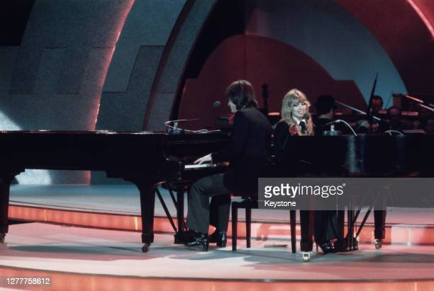 English singer-songwriter Lynsey de Paul duets with songwriter Mike Moran at the Eurovision Song Contest, performing their song 'Rock Bottom',...
