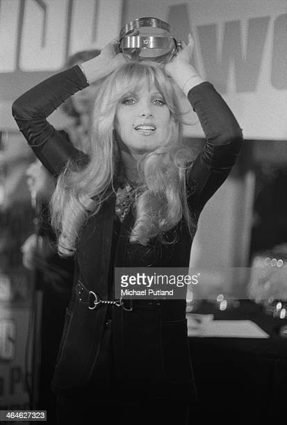 English singersongwriter Lynsey de Paul holding an award at the Disc magazine readers' poll awards February 1974