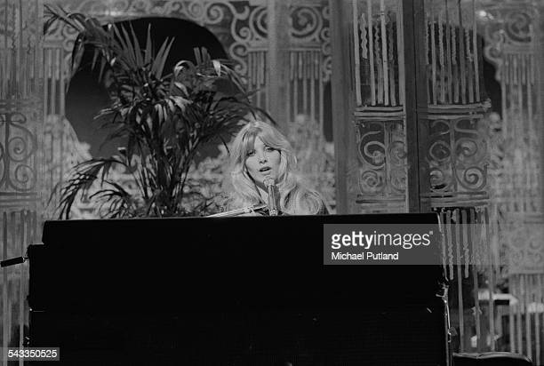 English singersongwriter Lynsey de Paul performing at a piano March 1975
