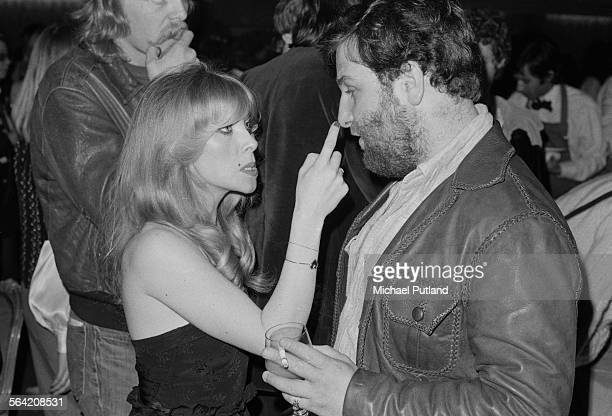 English singersongwriter Lynsey de Paul with English concert promoter Harvey Goldsmith at a party given by American rock group The Eagles 26th April...