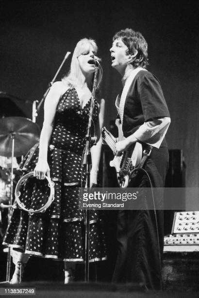 English singersongwriter multiinstrumentalist and composer Paul McCartney and Linda McCartney performing with the Wings at Hammersmith Odeon London...