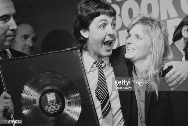 English singersongwriter multiinstrumentalist and composer Paul McCartney celebrating with his wife Linda Eastman at a dinner in his honour hosted by...