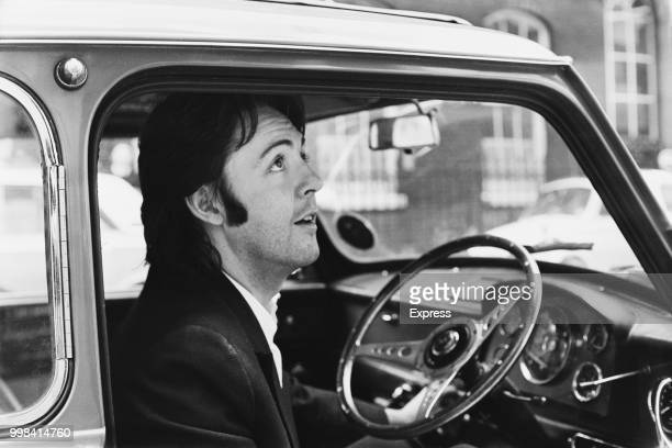 English singer-songwriter, multi-instrumentalist, and composer Paul McCartney leaving Apple Headquarters in his Mini car, London, UK, 19th April 1969.