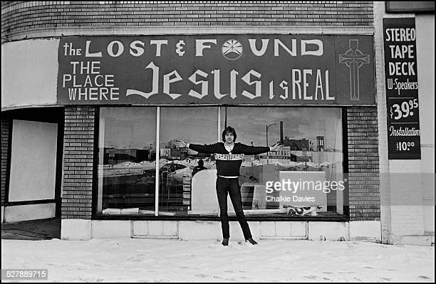 English singersongwriter Nick Lowe in front of a thrift shop in Buffalo New York March 1978