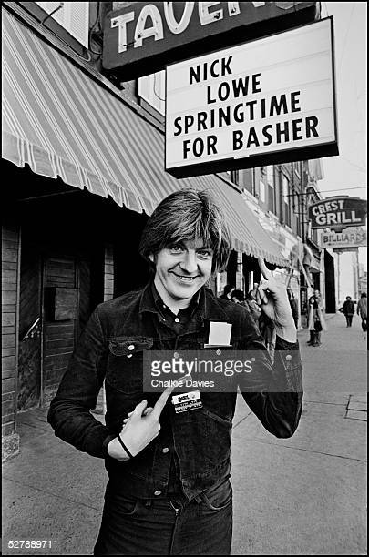 English singersongwriter Nick Lowe outside the El Mocambo Nightclub in Toronto in March 1978 The sign reading 'Springtime for Basher' references Mel...
