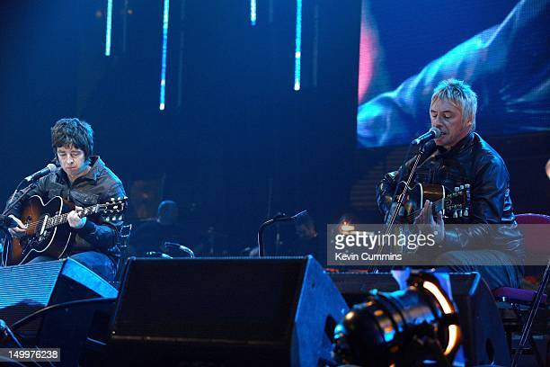 English singer-songwriter Paul Weller performing with Noel Gallagher at the Versus Cancer charity concert at the Manchester Evening News Arena, 30th...