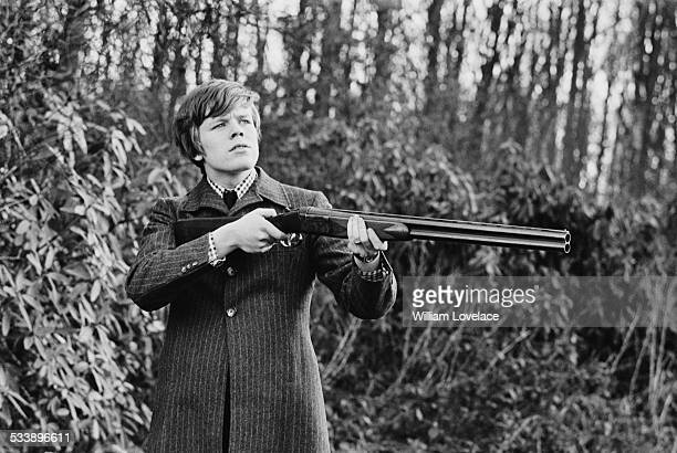 English singersongwriter Peter Noone of pop group Herman's Hermits holding a shotgun Kent 17th February 1967