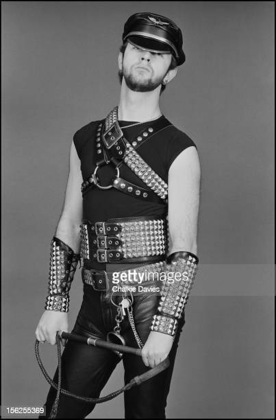 English singersongwriter Rob Halford of heavy metal group Judas Priest posing in fetish wear and holding a whip London 1979