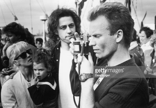 English singersongwriter Sting takes a picture with a panoramic camera at the Sport Aid charity run London 25th May 1986 Behind him singersongwriter...