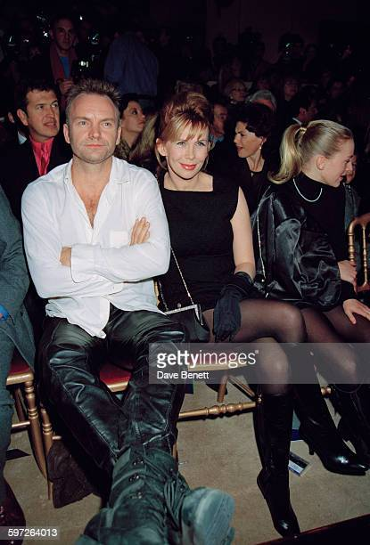 English singersongwriter Sting with his wife Trudie Styler at the Gianni Versace Haute Couture Summer 1996 launch at the Hotel Ritz Paris France 20th...