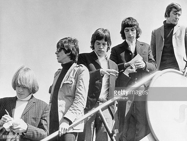English singing sensations The Rolling Stones are shown as they leave an airplane. Left to right: Brian Jones, Keith Richards, Mick Jagger, Bill...