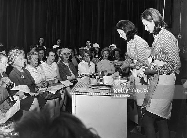 English sisters Celia and Juliet Wills give a demonstration of their Cordon Bleu cooking skills to a group of housewives in Hereford 5th July 1968