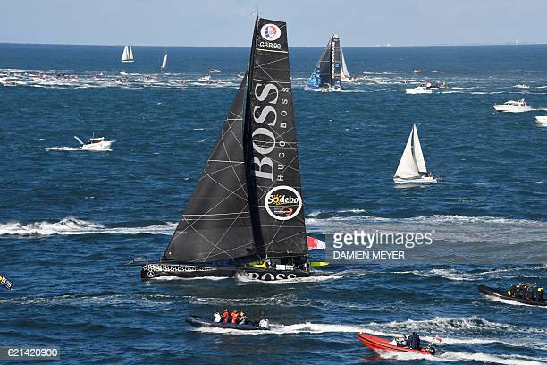 English skipper Alex Thomson sails onboard his class Imoca monohull 'Hugo Boss' sails after the start of the Vendee Globe solo aroundtheworld sailing...