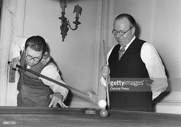 English snooker players Fred Davis and John Pulman during a World Professional Snooker Championship match at Soho Square Pulman executes a 'jumping'...