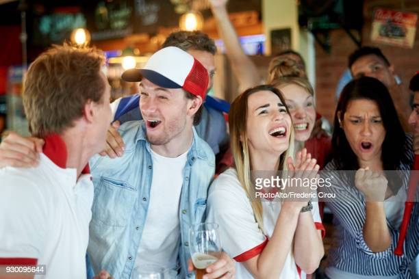 english soccer fans watching math together at pub - football fan stock photos and pictures