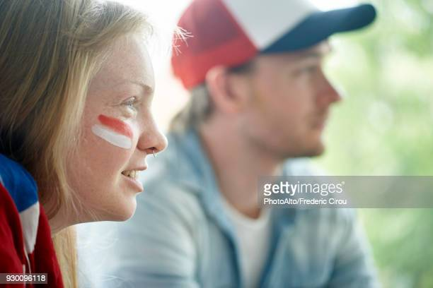 English soccer fans watching televised match together