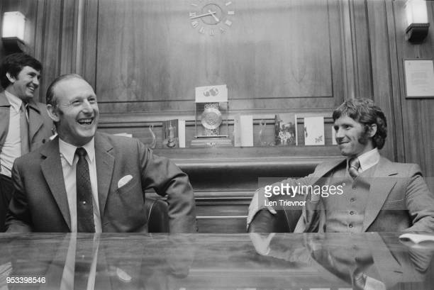 English soccer player Alan Ball Jr with English former soccer player and manager Bertie Mee after signing with Arsenal FC, UK, 23rd December 1971.