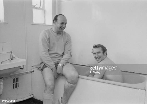English soccer player and manager of Bristol City FC Alan Dicks taking a bath while English soccer player and Bristol City FC youth coach John...