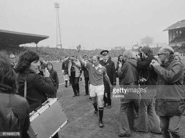 English soccer player Bobby Charlton of Manchester United FC greeting the crowd while leaving Stamford Bridge Stadium London UK 28th April 1973 The...