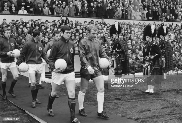 English soccer player Bobby Moore and Scottish soccer player John Greig lead out their teams prior kickoff of England vs Scotland game UK 24th...