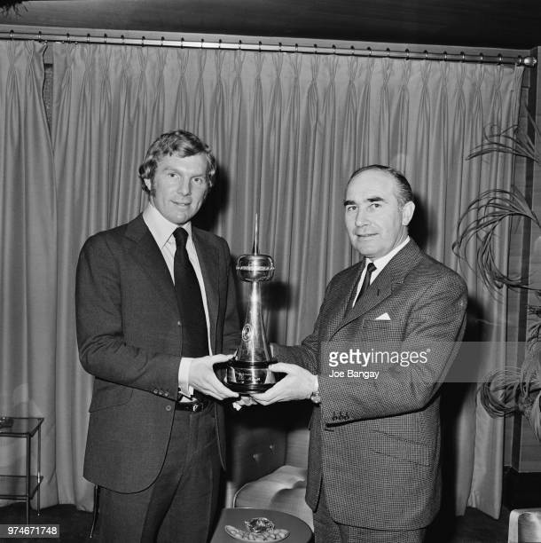 English soccer player Bobby Moore awarded 'Sportsman of the Month' by English former soccer player and manager of England national football team Alf...