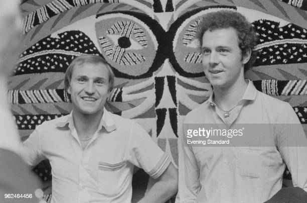 English soccer player Dennis Tueart and German soccer player Franz Beckenbauer UK 22nd September 1978
