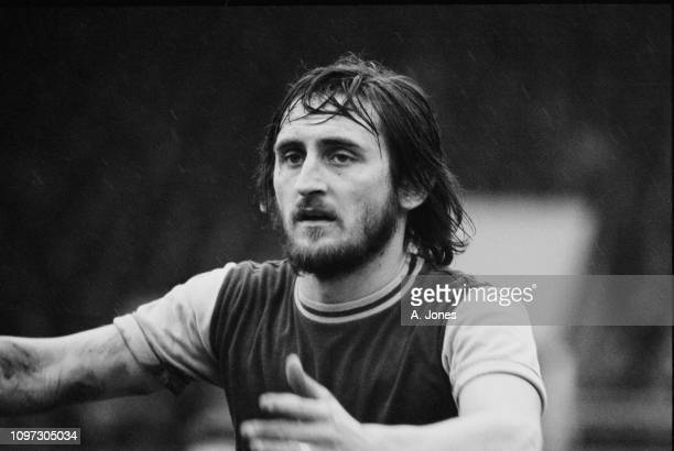 English soccer player Frank Lampard of West Ham United during a match against Burnley FC at Upton Park, London, UK, 15th March 1975.