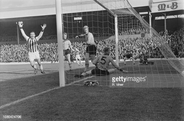 English soccer player Jeff Astle of West Bromwich Albion FC scores during a match against Wolverhampton Wanderers FC, UK, 10th October 1964.