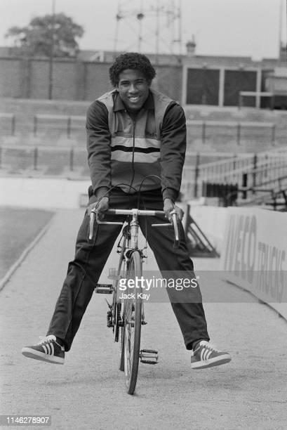 English soccer player John Barnes of Watford FC riding a bicycle UK 17th May 1984
