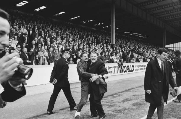 English soccer player Peter Osgood hugs Chelsea FC manager Tommy Docherty after winning FA Cup semi-finals against Leeds United FC, Villa Park,...