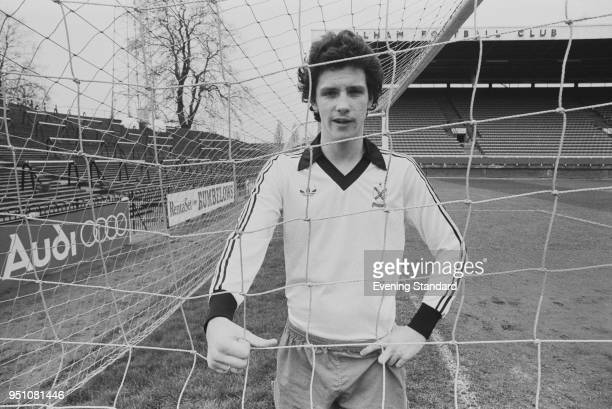 English soccer player Tony Gale of Fulham FC standing inside a football goal, UK, 24th February 1978.