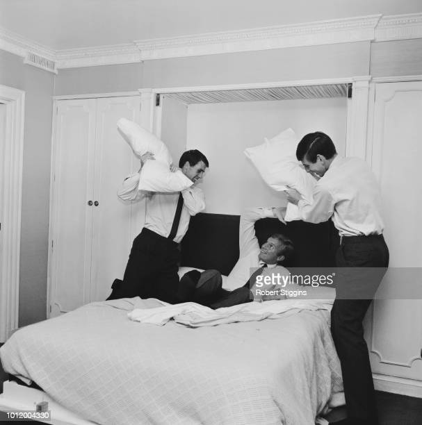 English soccer players Geoff Hurst Bobby Moore and Martin Peters during a friendly pillow fight celebrating their victory at the 1966 FIFA World Cup...